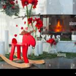 Fireplace Decor With Candles And Red Flowers Rocking Chair