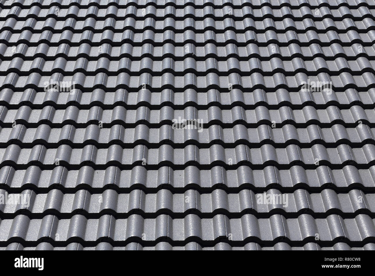 https www alamy com black tiles roof on a new house image228662148 html