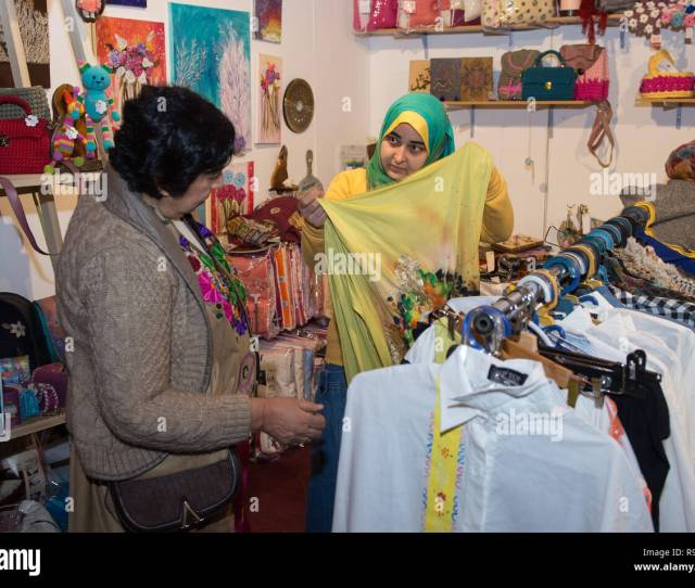 A Woman Displays An Item To A Visitor At A Stall During The 2018 International Handicrafts Show Ihs 2018 In Cairo Egypt On Dec 19 2018