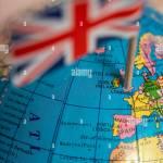 British Flag On The World Map Uk Flag Pricked On The Globe Points To The United Kingdom Stock Photo Alamy