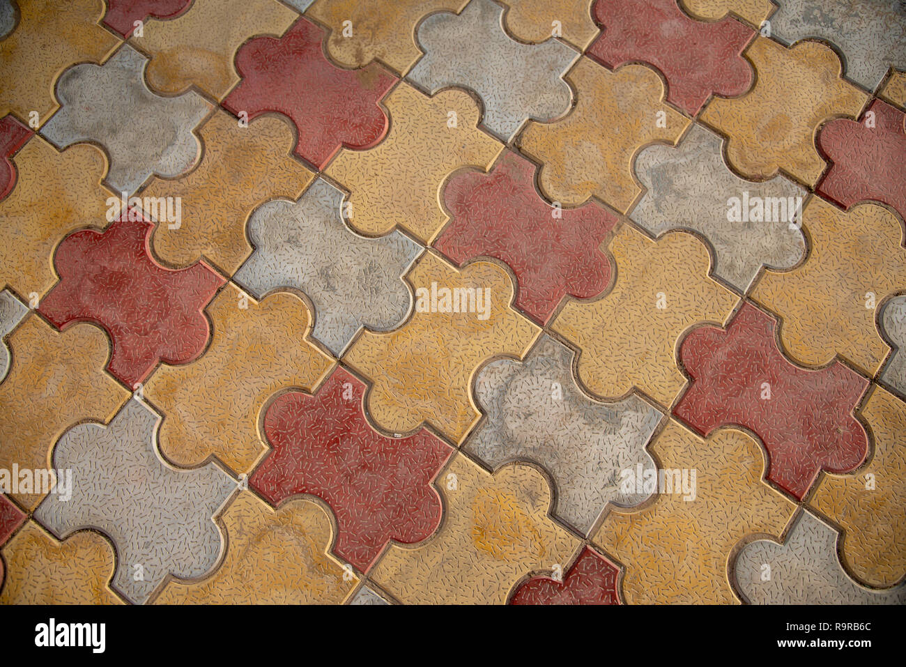 https www alamy com jigsaw floor tiles each vibrant floor tile fitting together like a puzzle piece oxford shape image229780388 html