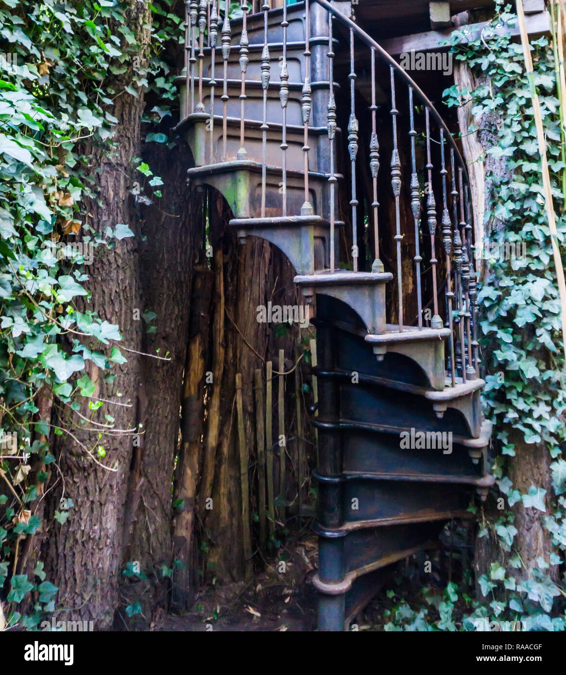 Vintage Iron Spiral Staircase In A Garden Outdoor Architecture | Iron Spiral Staircase For Sale | Grey Exterior | Wrought Iron | Ornate | Helical Staircase | Architectural Salvage