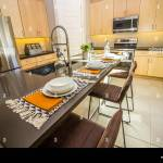 Granite Kitchen Counter Island With Stools And Place Settings Stock Photo Alamy