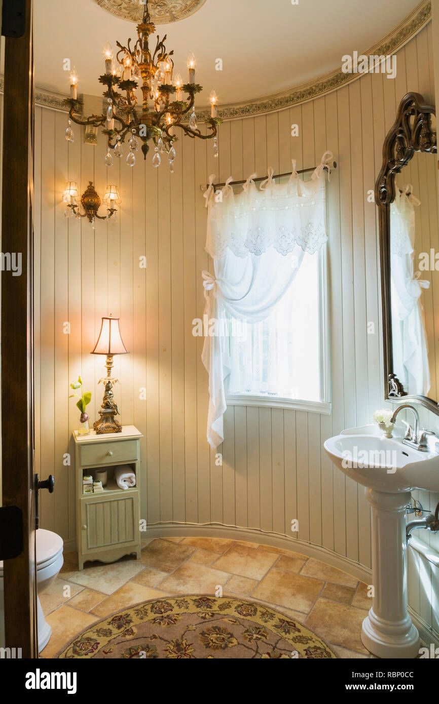 https www alamy com white porcelain pedestal sink toilet small wooden cabinet and lamp in guest bathroom inside a 2006 reproduction of a 16th century renaissance castle image230979292 html