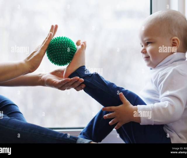 Mother Makes Foot Massage To Her Son She Is Holding Massage Ball Little Boy Is Smiling He Is Tickled Family Care Prevention Of Flatfoot