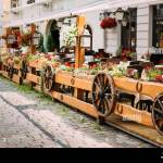 Exterior Of Cozy Outdoor Street Cafe In Retro Rural Rustic Style On Wooden Wall Of Cafe Or Restaurant Hanging Wooden Wheels From Peasants Carts Stock Photo Alamy