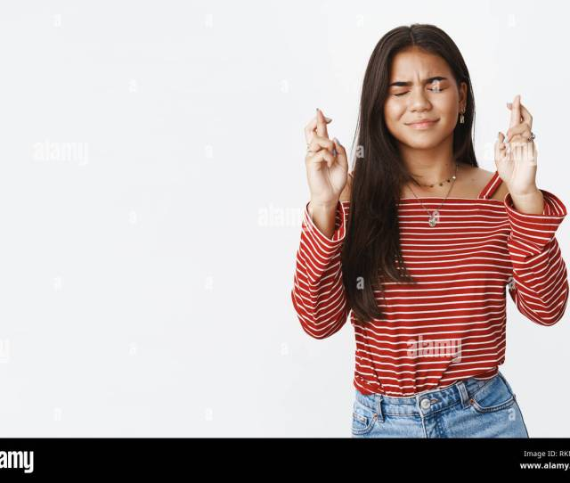 Waist Up Shot Of Worried Cute Indian Teenage Girl With Dark Long Hair Close Eyes
