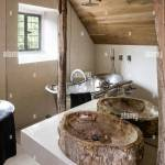 Bathroom With Mirrored Wall Bisecting Reclaimed Beams Sourced In Indonesia With Italian Marble Floor And Walls Stock Photo Alamy