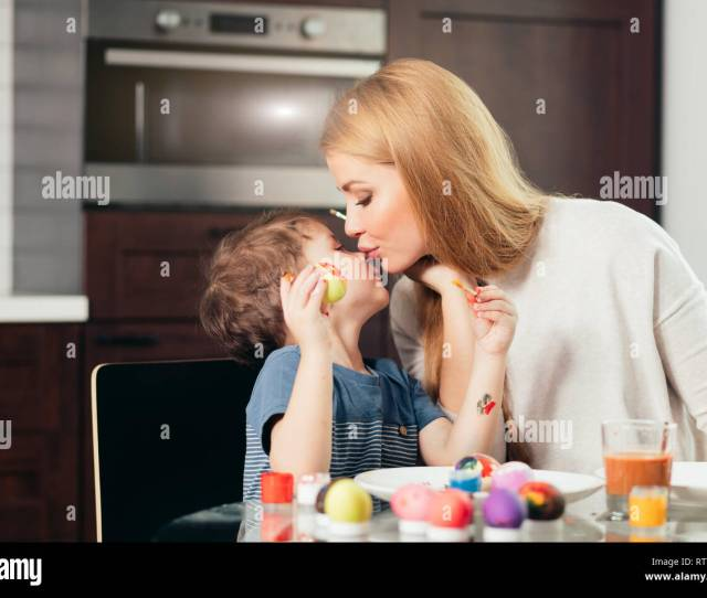 Happy Blonde Mother And Four Year Old Son Making Homemade Easter Eggs Enjoying Leisure
