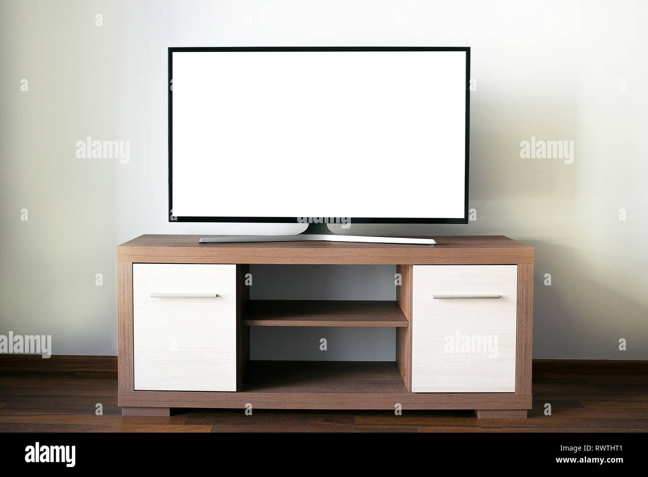 Big Flat Lcd Television With A Blank Screen On A Wooden Tv Stand Stock Photo Alamy