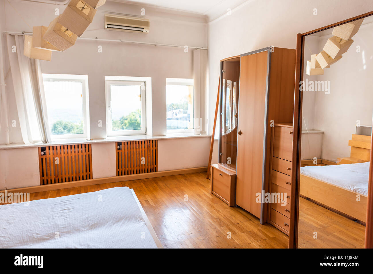 https www alamy com new clean white bed simple minimalist light wood wooden wardrobe cabinet closet or armoire in bedroom home house or apartment image241961768 html