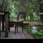 Wooden Tables And Chairs Located In Bamboo Gardens Along The Canal Stock Photo Alamy