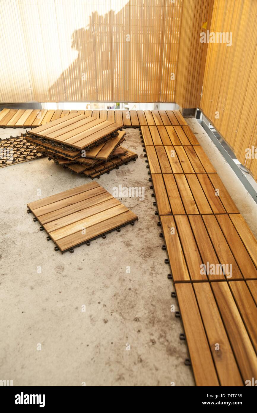 https www alamy com laying of wooden patio tiles on a balcony germany europe image243940180 html