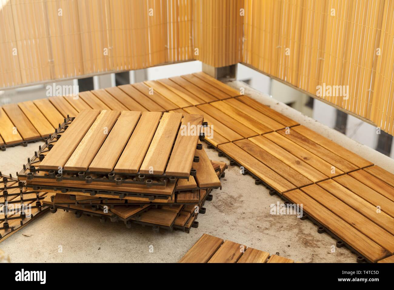 https www alamy com laying of wooden patio tiles on a balcony germany europe image243940185 html