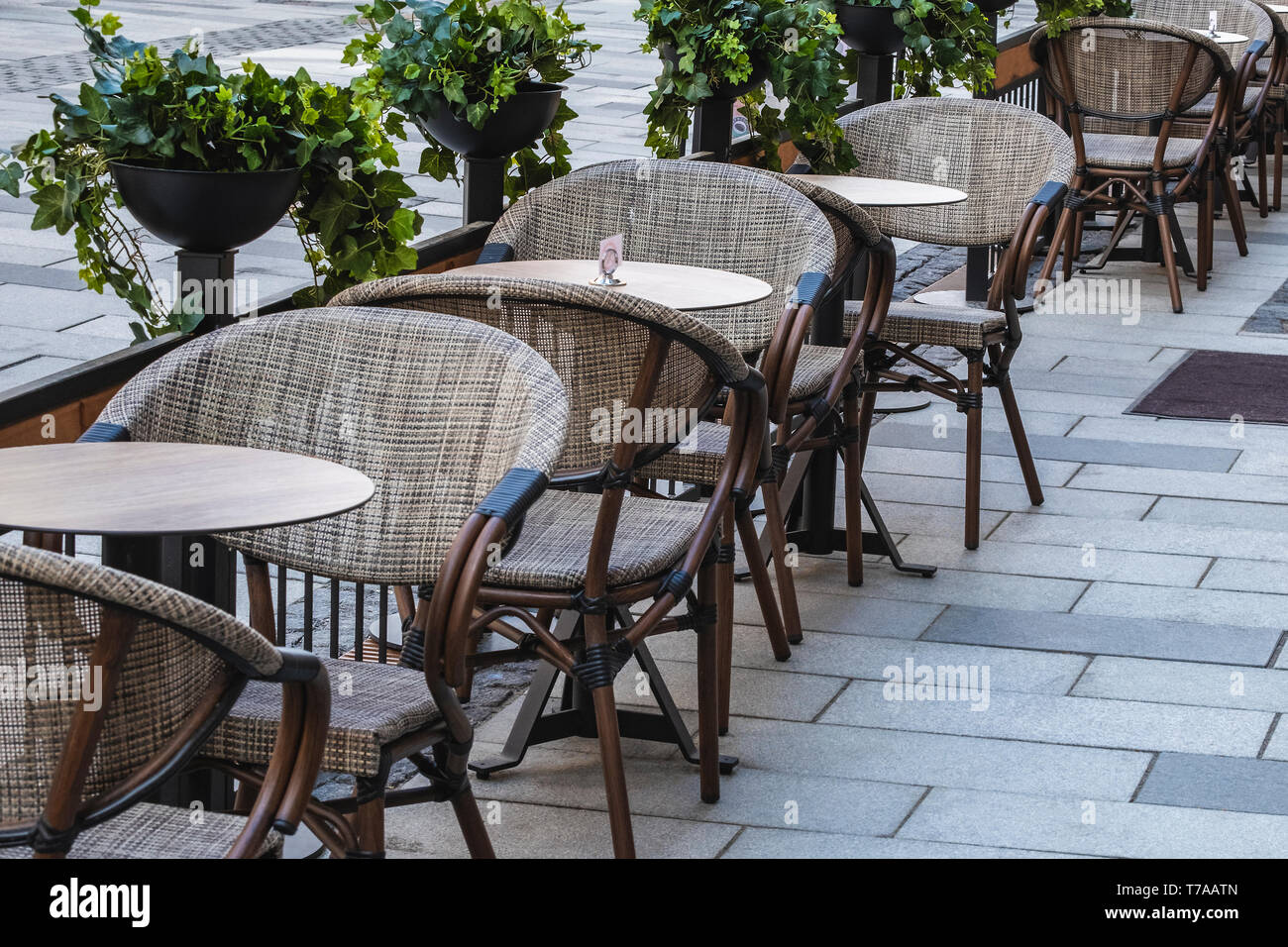 https www alamy com empty chairs and tables in a outdoor restaurant on a cold sunday afternoon image245475797 html