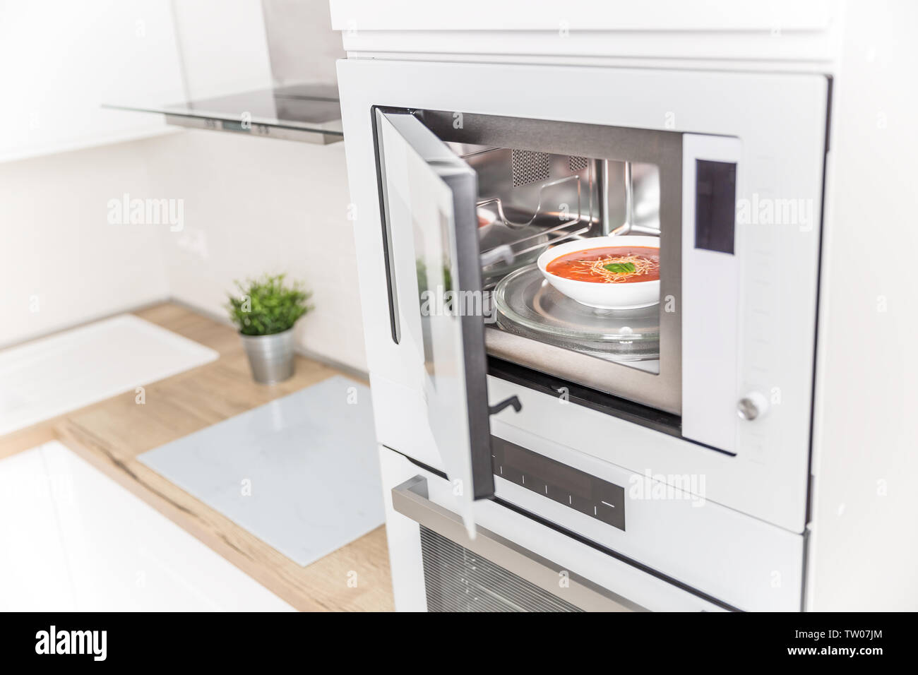 https www alamy com built in microwave oven in the kitchen with tomato soup in white plate image256317564 html