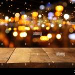 Background Of Wooden Table In Front Of Abstract Blurred Restaurant Lights Stock Photo Alamy