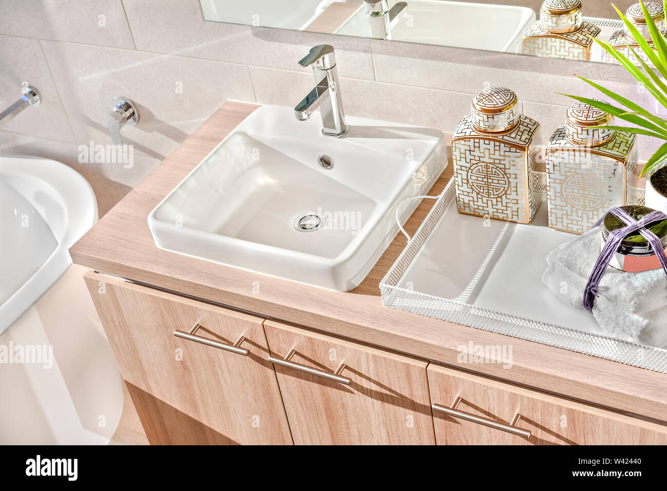 https www alamy com top view of a silver taps and white sink on the wooden counter with soap and towel under the mirror near tub image260661296 html