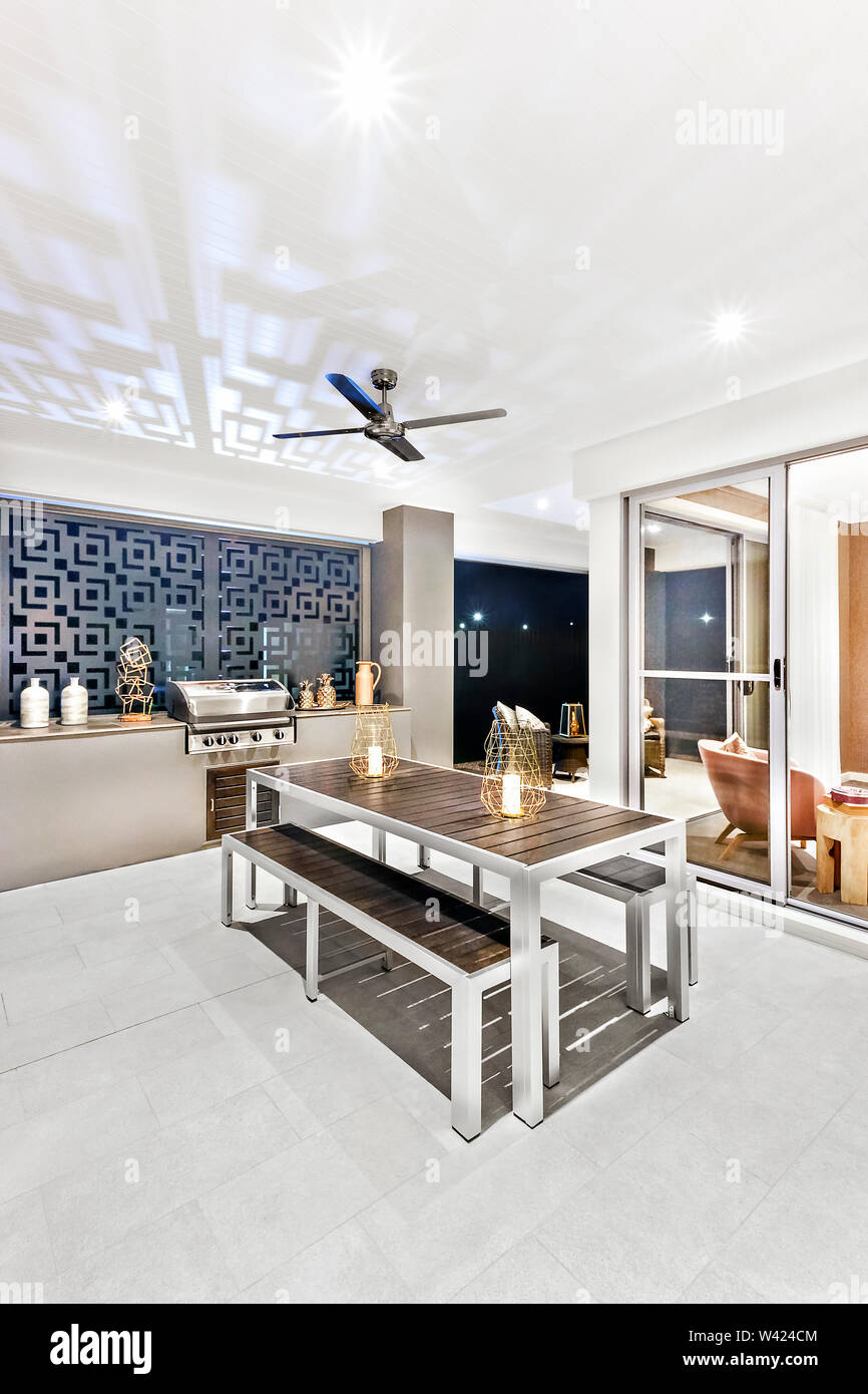 https www alamy com room with a dining area and tile floor there is black wooden table with a bench beside the glass door entrance fan can see on ceiling luxury home i image260661540 html