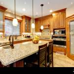 Luxury Kitchen With Light Brown Cabinets Steel Appliances Pantry Marble Counter Top Island Stock Photo Alamy