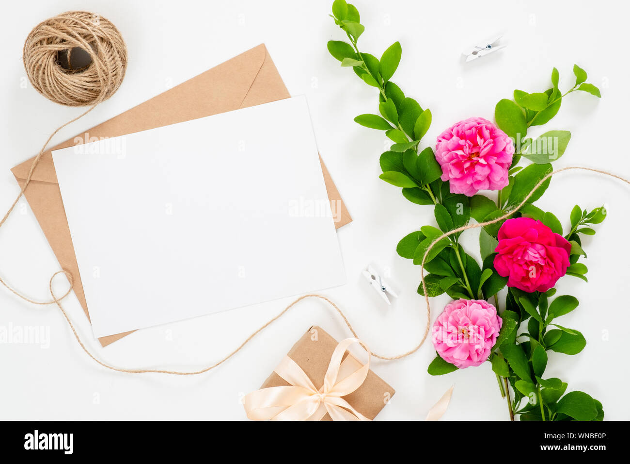 https www alamy com wedding invitation card blank paper card craft envelope ribbon and bouquet of pink rose flowers on white background minimal flat lay style composi image271315766 html
