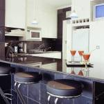 Three Different Kitchen Styles Kitchen Black Rough Slate Tiles On Wall White Cupboards And White Kitchen Units Black Marble Stock Photo Alamy