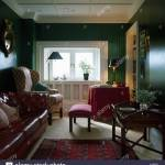 Wing Chair And Brown Leather Sofa In Dark Green Living Room