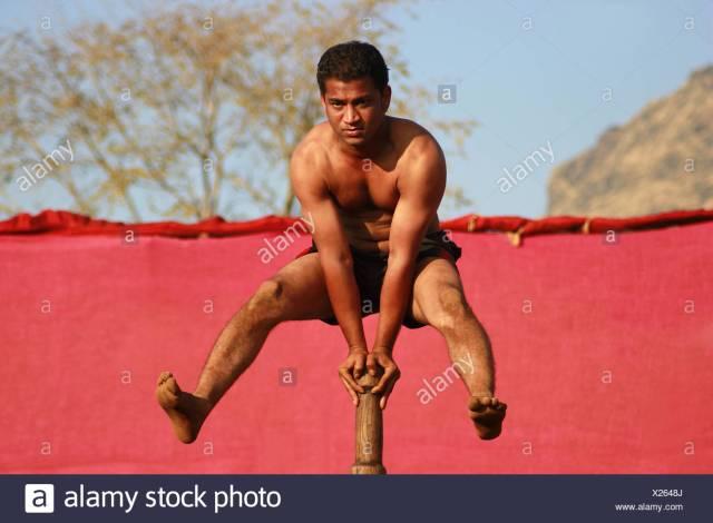 Man doing pole gymnastics (Mallakhamb) at raigad festival ...