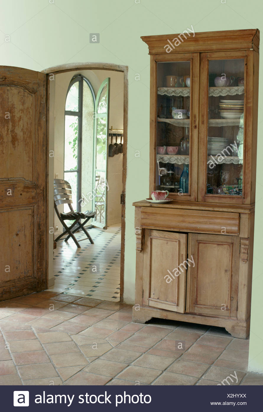 https www alamy com antique glass front dresser in french country hall with terracotta floor tiles image276990306 html