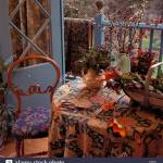 Chair With Blue Upholstered Seat And Table With Trug And Patterned Cloth Beside Blue Half Glazed Double Doors To Veranda Stock Photo Alamy