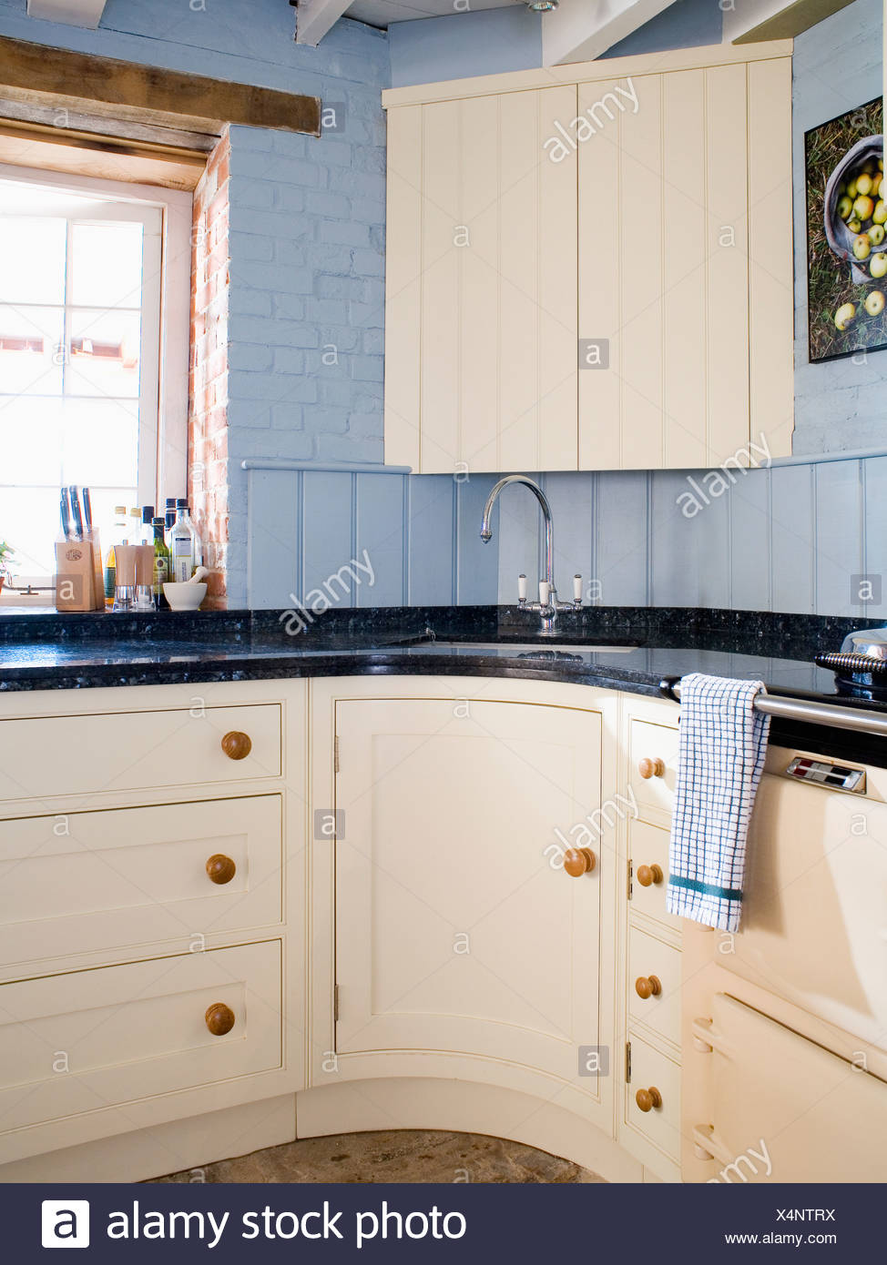 https www alamy com cream corner cupboard above sink in pale blue country kitchen with cream fitted cupboards and units image278304990 html