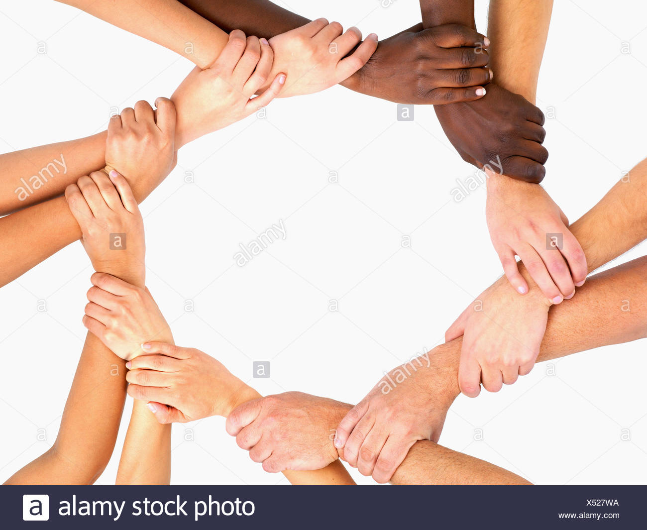 Clasped Hands In A Circle Stock Photo