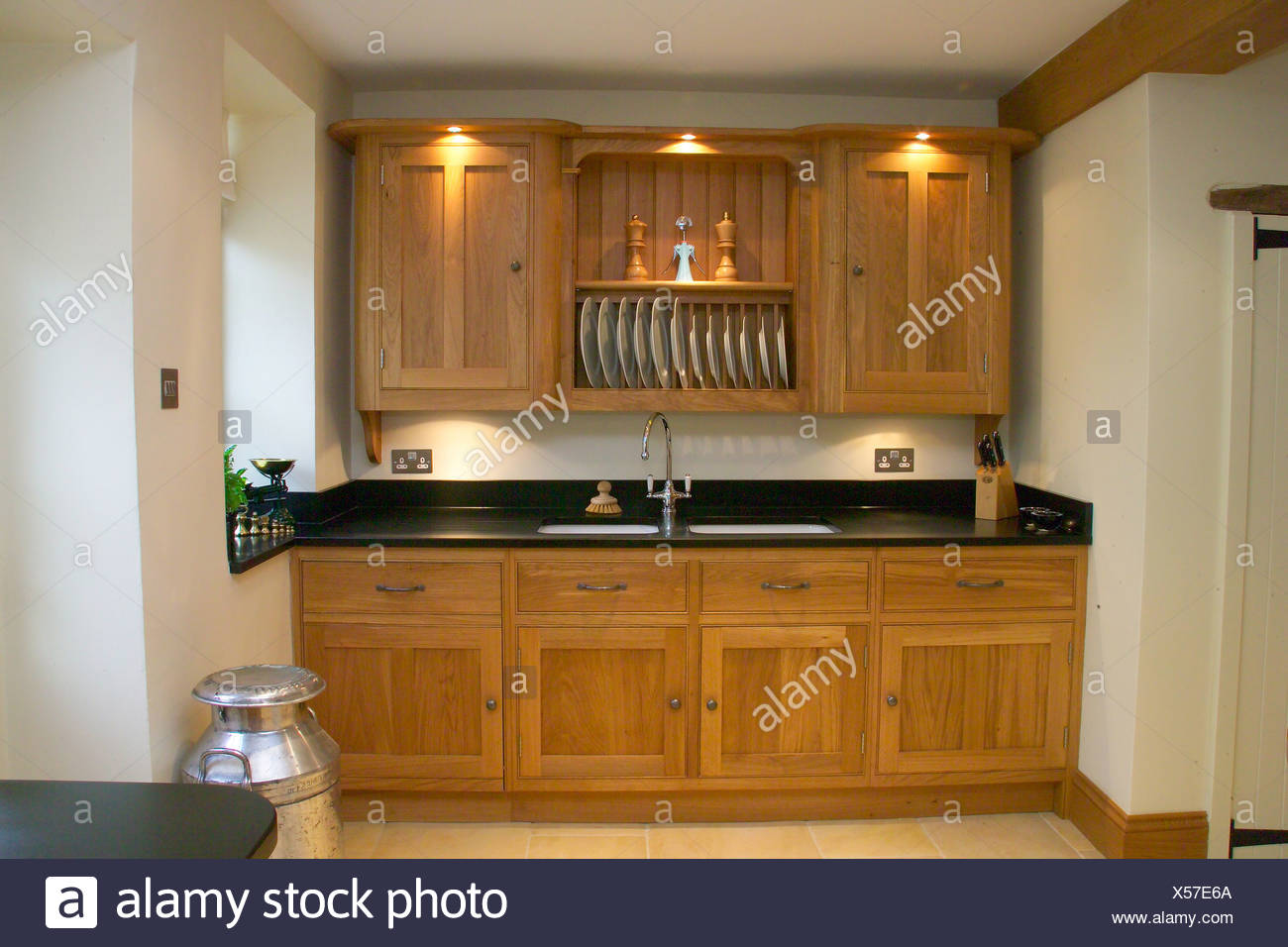 https www alamy com lighting above wooden kitchen cupboards with built in sink in modern kitchen image278603986 html