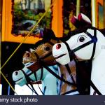 Colourful Antique Carousel Horses On A Merry Go Round Stock Photo Alamy