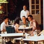 Two Young Couples In Outdoor Cafe With Waiter In Background Singapore Stock Photo Alamy