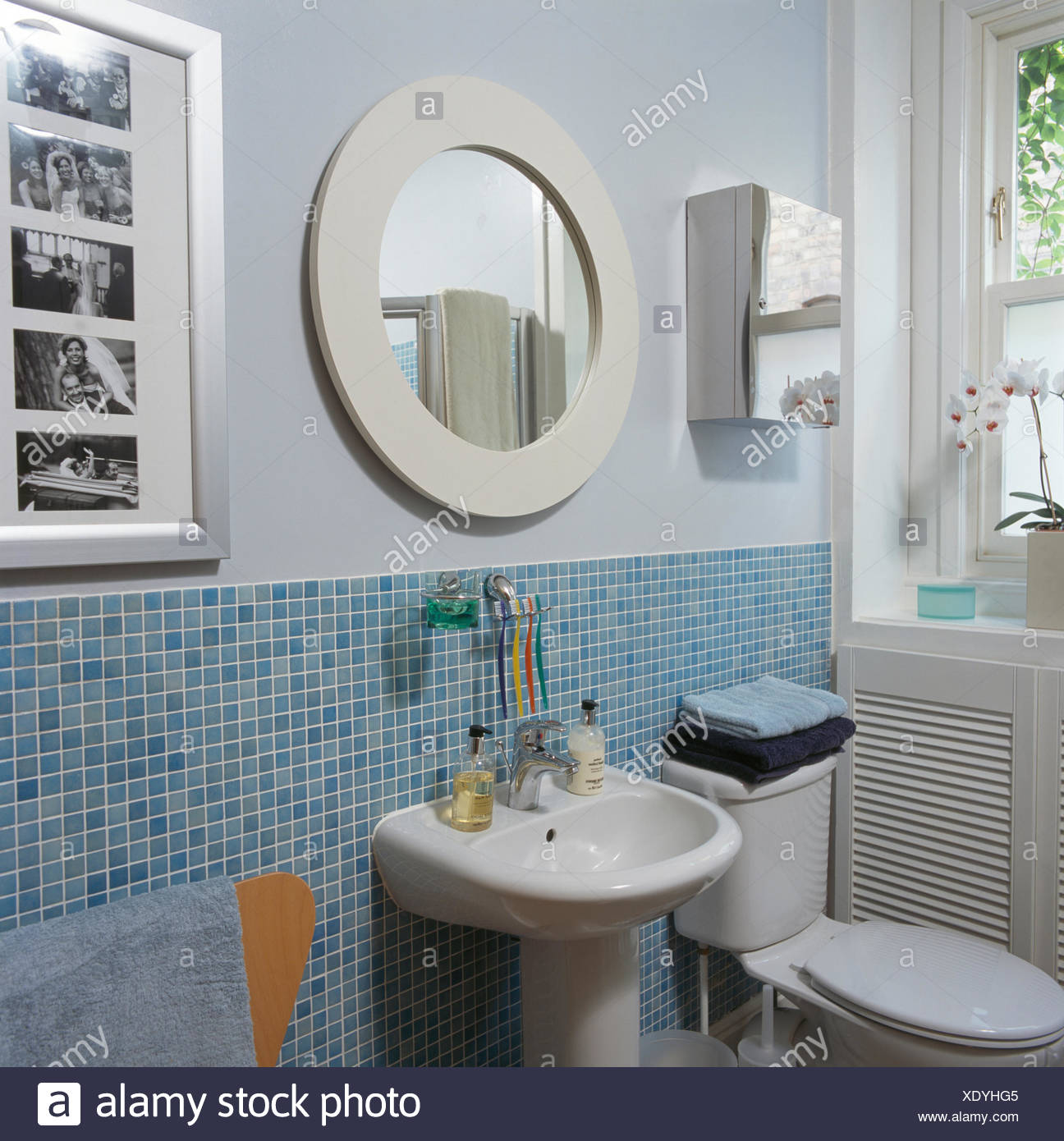 https www alamy com circular white mirror above basin in modern bathroom with light blue mosaic tiling image283962901 html