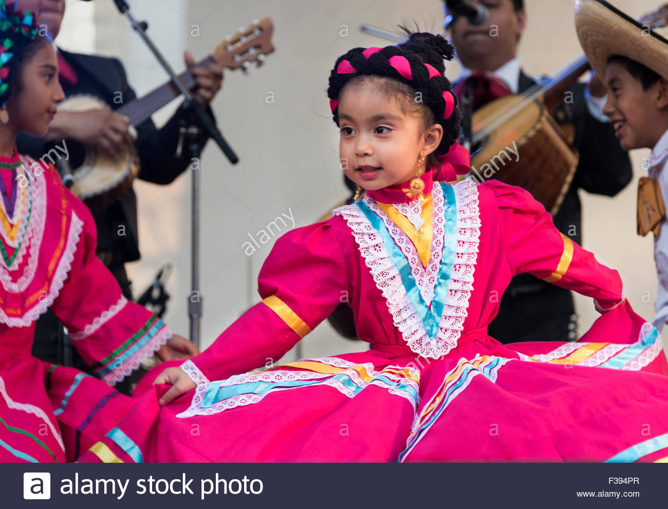 Children And Young Women Performing Mexican Folkloric Dance