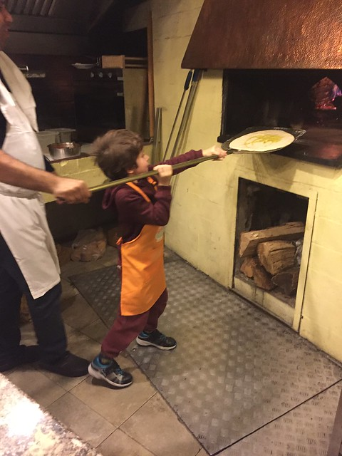 The pizza making class in Rome included cooking with a real wooden fire oven