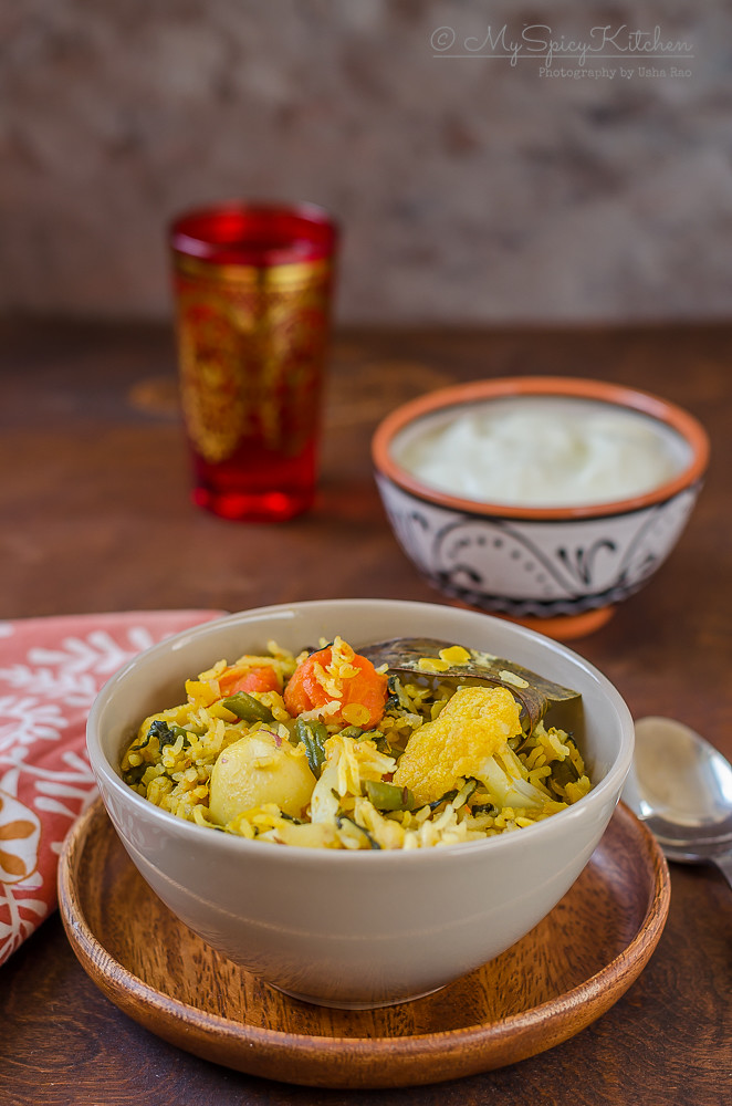 Bowl of Toor Dal Vegetable Khichdi on a wooden plate,