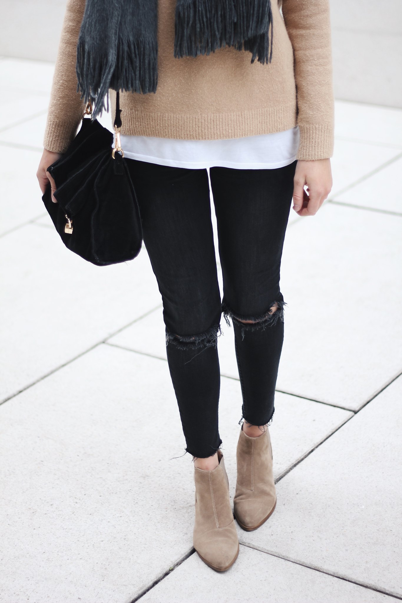 beige sweater, ripped jeans, vagabond boots