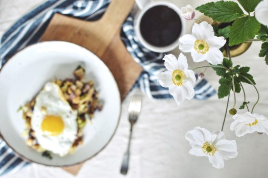 Potato onion apple cabbage hash topped with a fried egg