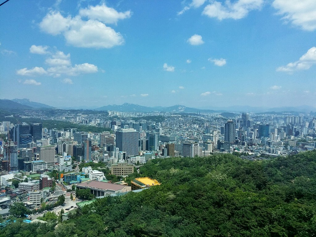 The buildings, blue sky and green trees of Seoul City
