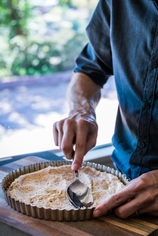 pressing the crust into the tart pan