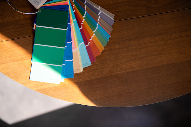 Various color swatches fanned out on a table