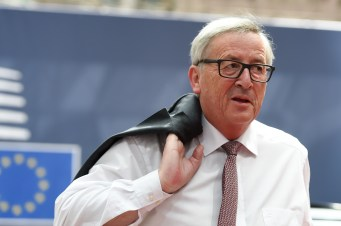 Jean-Claude Juncker, holding his jacket over his shoulder