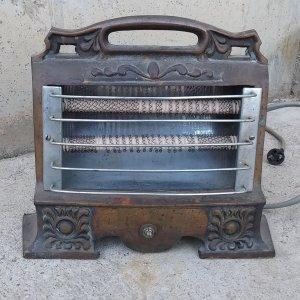 Estufa elèctrica antiga de ferro colat 100% funcional a cabauoportunitats.com