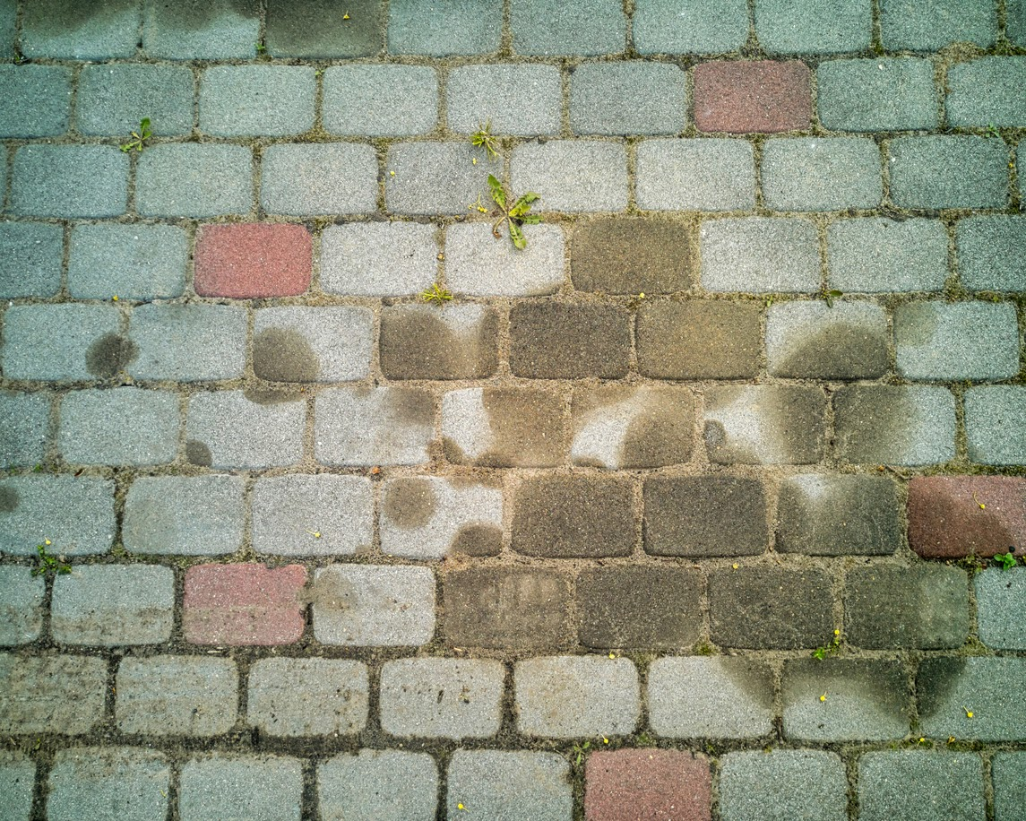 oil and fuel stain removal from concrete asphalt patio and pavers cabeno environmental