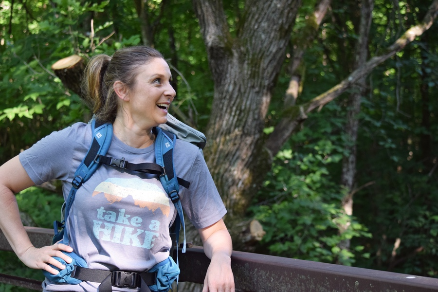 "Woman wearing grey shirt that says ""Take a Hike"""