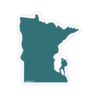 green Minnesota shaped sticker with a female hiker