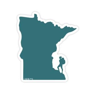 green Minnesota shaped sticker with a female hiker